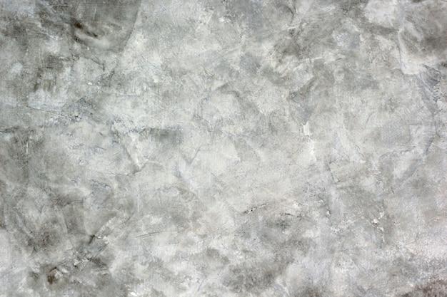 Фоновая текстура цементной штукатурки имеет белый и серый цвет.