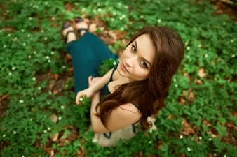 The beautiful girl sitting on the ground