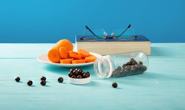 人間の視覚のためにブルーベリーとニンジンを食べることの利点と害。