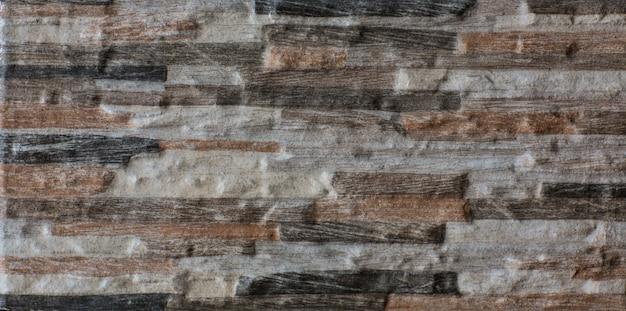 固体石のブロック灰色の石の壁ヴィンテージ素朴な風化した不均一な背景
