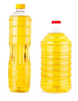 白で隔離されるひまわり油のボトル