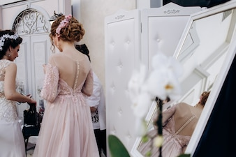 The bridesmaid stands in the room