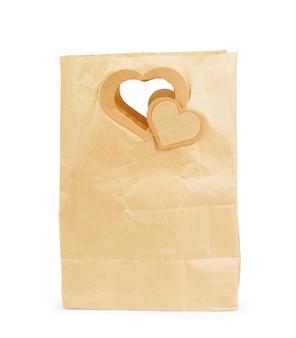 茶色の紙のパッケージは白で隔離されています