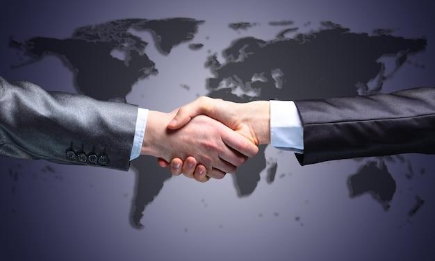 ビジネスマン。握手のための手。トランザクションの終了。