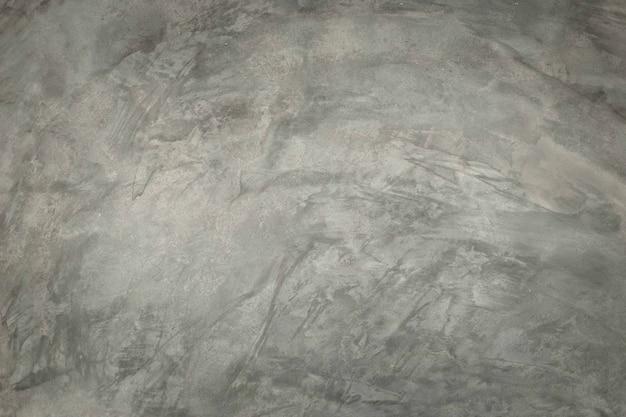 Цементная стена показывает рисунок стены здания и окрашена жидким раствором.