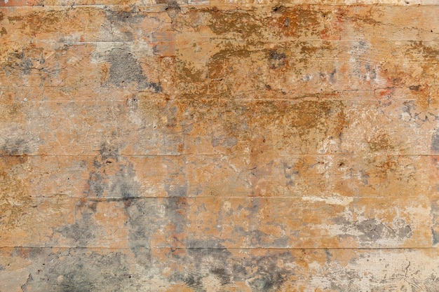 ベージュ色の中世の古い石の壁の拡大図。