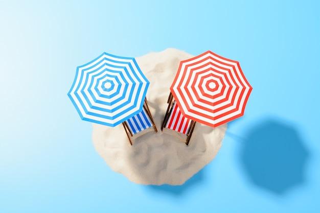 열대 휴가의 개념. 모래 위의 우산 아래 두 개의 일광욕 의자가있는 바다의 파라다이스 아일랜드, 평면도