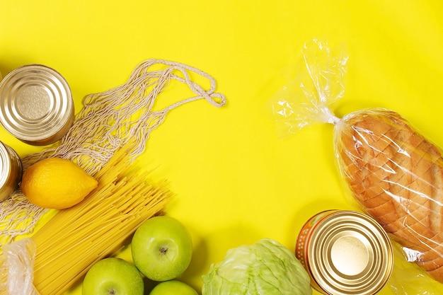 Различные продукты питания на желтом фоне