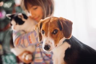The dog sitting near girl