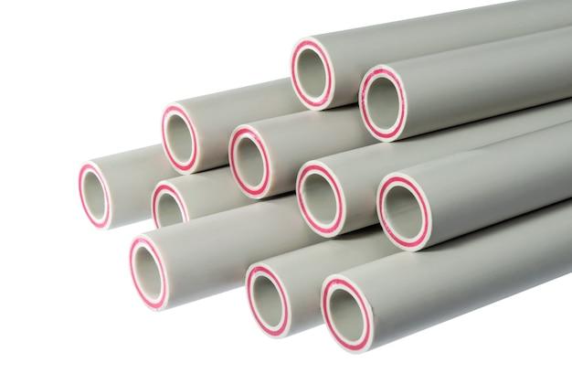 Концы пластиковых водопроводных труб на белом