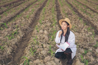The female doctor examines soil with a modern concept book.