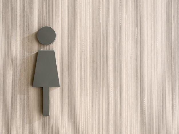 Значок женщины на фоне вертикального рисунка