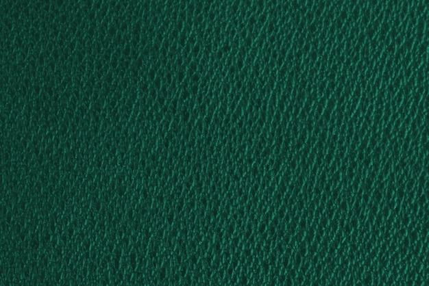 Зеленая гофрированная текстура при ярком свете