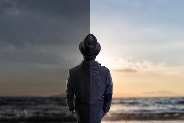 海を見ている帽子の男