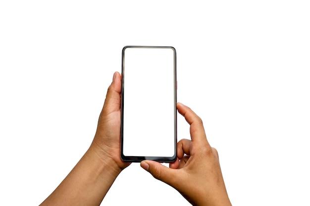 手は白い画面を持っており、携帯電話はクリッピングパスで白い背景に隔離されています。