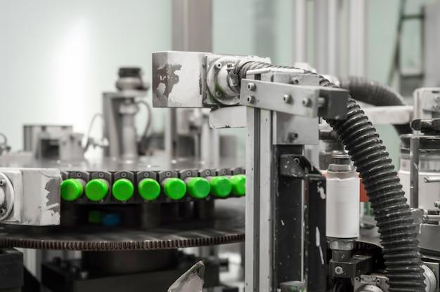 기계는 플라스틱 뚜껑에 인쇄합니다. 플라스틱 캡에 인쇄
