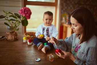 The mother and son painting Easter eggs