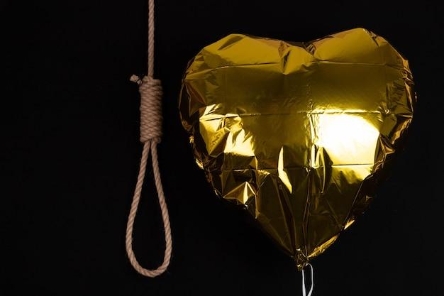 不機嫌な背景、失敗または自殺の概念に対する縄