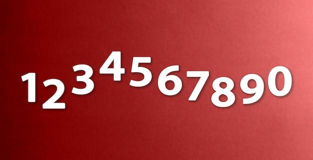 Цифры от нуля до девяти на бумаге разного цвета фона.
