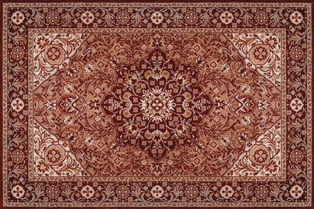 Текстура старого коричневого персидского ковра, абстрактный орнамент Premium Фотографии