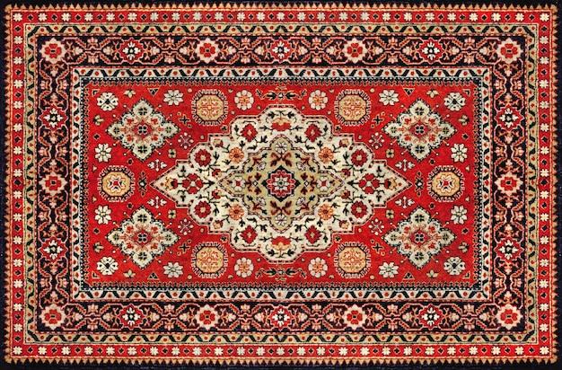 Старый красный персидский ковер текстуры, абстрактный орнамент