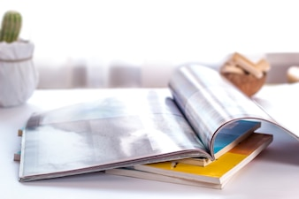 The open pages of the magazine lie on the table.