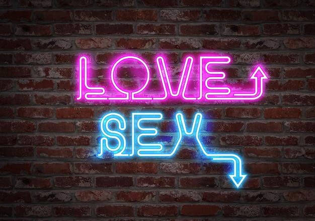 レンガの壁に明るいネオンが書いた愛またはセックスというフレーズ