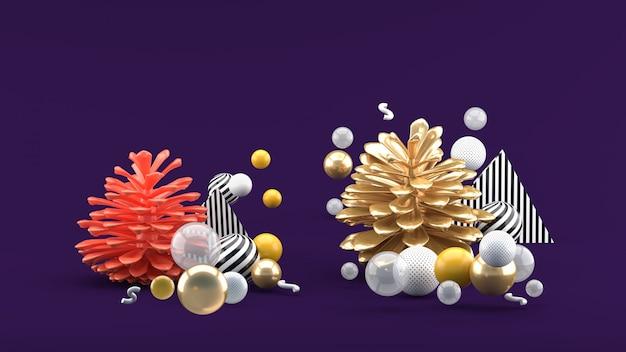 紫色のスペースにカラフルなボールの中で松ぼっくり