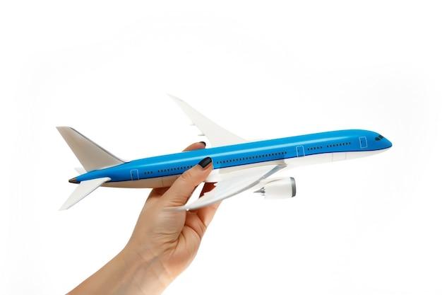 飛行機は思いやりのある手にあります。航空業界のサポートコンセプト。