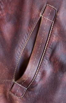 Карман куртки из натуральной кожи
