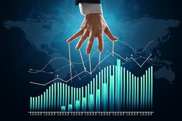 인형극의 남성 손은 재무 차트, 비즈니스 지표를 조작합니다. 그림자 정부, 세계 음모, 조작, 통제의 개념.