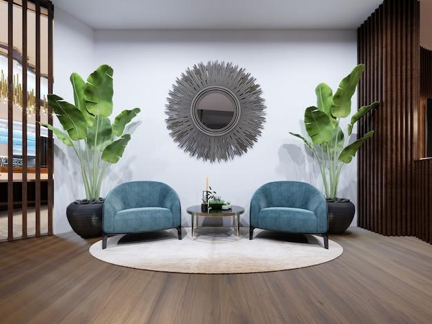 휴식 공간에는 파란색 디자이너 안락의자 2개가 있습니다.