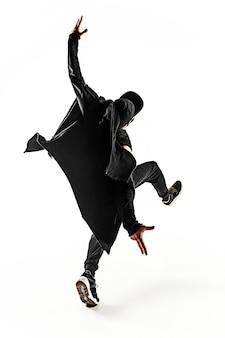 흰색 배경에서 춤을 추는 한 젊은 힙합 남성 브레이크 댄서의 실루엣