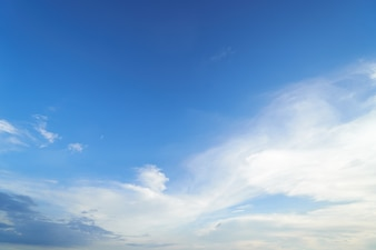 The sky is bright blue. There are clouds floating through. Feel relax