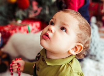 The small boy looking  at Christmas Tree