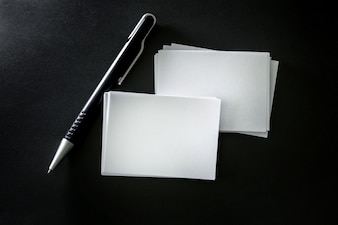The stacking of mockup empty white business card with elegance pen