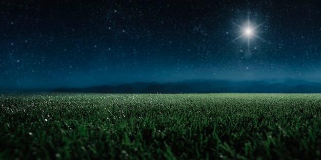 星はイエス・キリストのクリスマスの飼い葉桶の上に山で輝いています。