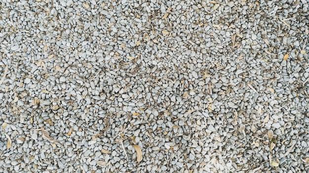 石の床と乾燥した葉のテクスチャの背景