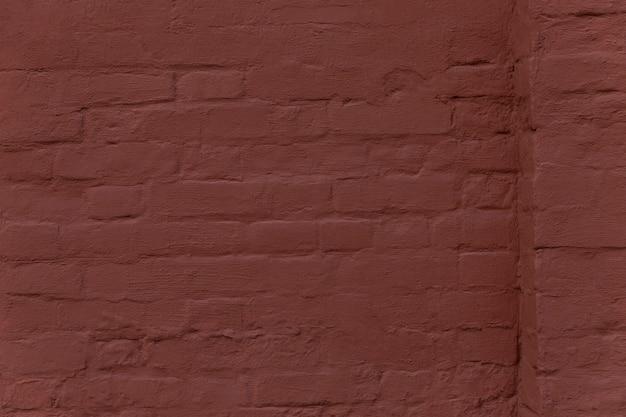Поверхность стены из коричневого кирпича с выступом. задний план. место для текста.