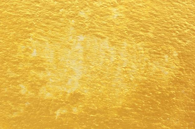 Поверхность цемента желтое золото.
