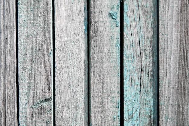 古い木製のフェンスの表面。風化したボード。青い木の板テクスチャ背景