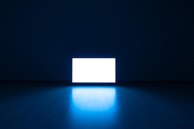 푸른 빛을 배경으로 한 바닥에 있는 텔레비전