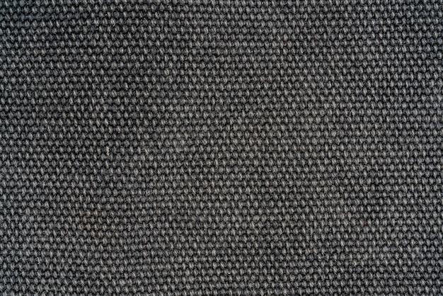 짙은 회색 모직 직물의 질감. 근접 섬유 배경입니다.