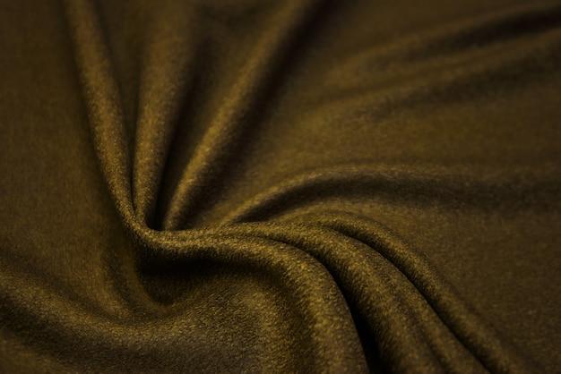 Фактура кашемировой ткани бежевого цвета. фон, узор.
