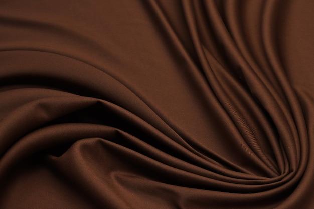 Фактура хлопчатобумажной ткани бежевого цвета. задний план,
