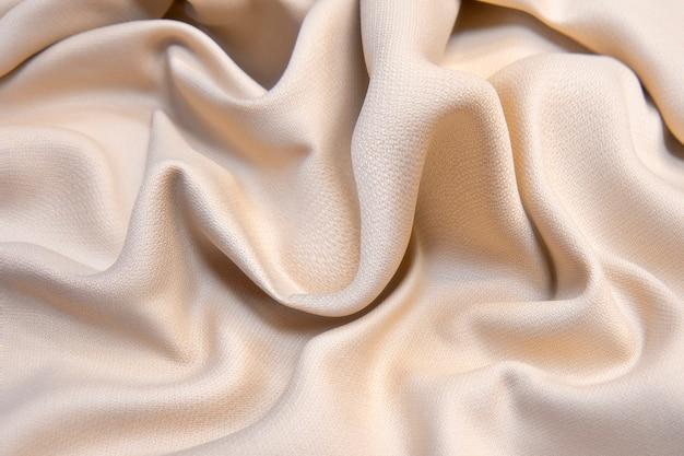 Фактура мятой бежевой мягкой теплой ткани. фланель.