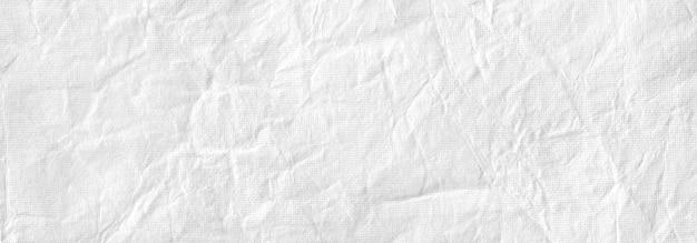 Текстура мятой белой мятой бумаги, старый морщинистый старинный фон