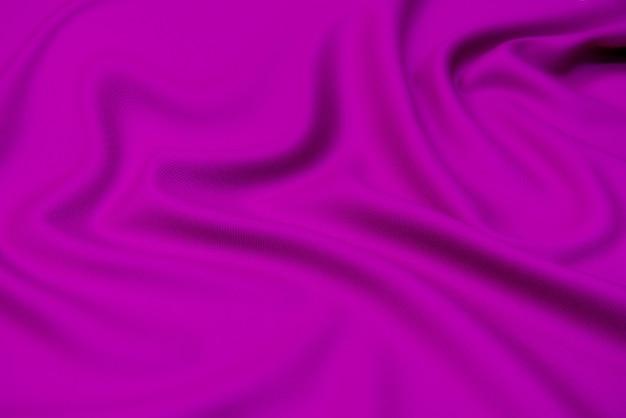 フクシアのシルク生地の風合い。背景、パターン。