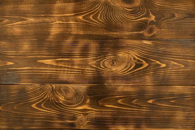 焦げた板の質感。上からの眺め。古い木の板。
