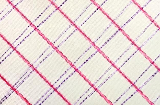 분홍색과 보라색 줄무늬가 있는 면직물의 질감
